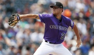 Colorado Rockies starting pitcher Kyle Freeland works against the San Francisco Giants in the first inning of a baseball game Sunday, Aug. 4, 2019, in Denver. (AP Photo/David Zalubowski)