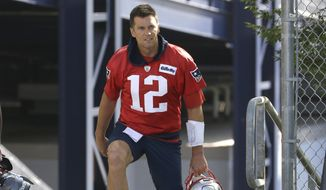 New England Patriots quarterback Tom Brady steps on the field at the start of an NFL football training camp practice, Thursday, July 25, 2019, in Foxborough, Mass. (AP Photo/Steven Senne) **FILE**