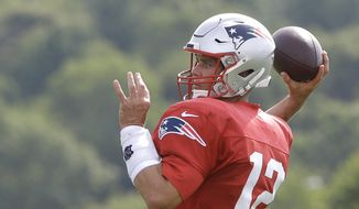 New England Patriots quarterback Tom Brady winds up to pass during an NFL football training camp practice, Thursday, Aug. 1, 2019, in Foxborough, Mass. (AP Photo/Steven Senne)