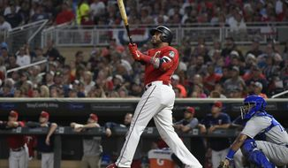 Minnesota Twins' Nelson Cruz watches his solo home run against the Kansas City Royals during the second inning of a baseball game Saturday, Aug. 3, 2019, in Minneapolis. (Aaron Lavinsky/Star Tribune via AP)