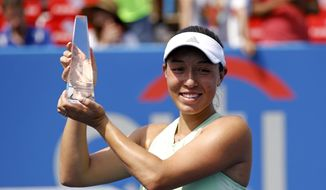 Jessica Pegula poses with a trophy after defeating Camila Giorgi, of Italy, in a final match at the Citi Open tennis tournament, Sunday, Aug. 4, 2019, in Washington. (AP Photo/Patrick Semansky)