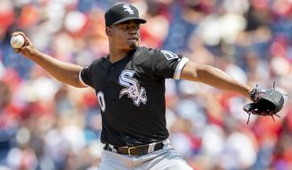 Chicago White Sox starting pitcher Reynaldo Lopez (40) throws during the first inning of a baseball game against the Philadelphia Phillies, Sunday, Aug. 4, 2019, in Philadelphia. (AP Photo/Laurence Kesterson)