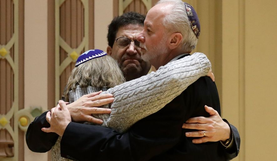 Rabbi Jeffrey Myers (right) said his Tree of Life Synagogue in Pittsburgh is compiling a book to help communities cope with mass shootings. (Associated Press/File)