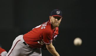 Washington Nationals starting pitcher Stephen Strasburg throws a pitch during the first inning of a baseball game against the Arizona Diamondbacks Saturday, Aug. 3, 2019, in Phoenix. (AP Photo/Ross D. Franklin) ** FILE **