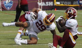 Washington Redskins running backs Shaun Wilson, right, and Derrius Guice (29) run drills during NFL football training camp in Richmond, Va., Monday, Aug. 5, 2019. (AP Photo/Steve Helber) **FILE**
