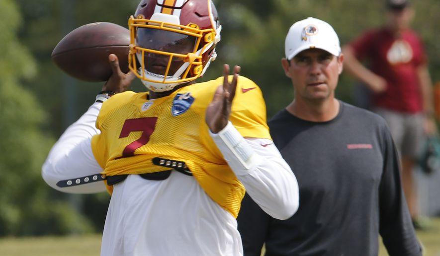 Washington Redskins quarterback Dwayne Haskins Jr. (7) tosses a pass during the Washington Redskins NFL football training camp in Richmond, Va., Monday, Aug. 5, 2019. (AP Photo/Steve Helber)