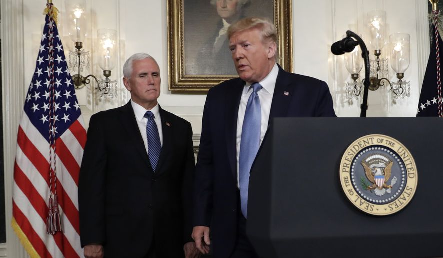 President Donald Trump walks away after speaking about the mass shootings in El Paso, Texas and Dayton, Ohio, in the Diplomatic Reception Room of the White House, Monday, Aug. 5, 2019, in Washington. Vice President Mike Pence is left. (AP Photo/Evan Vucci)