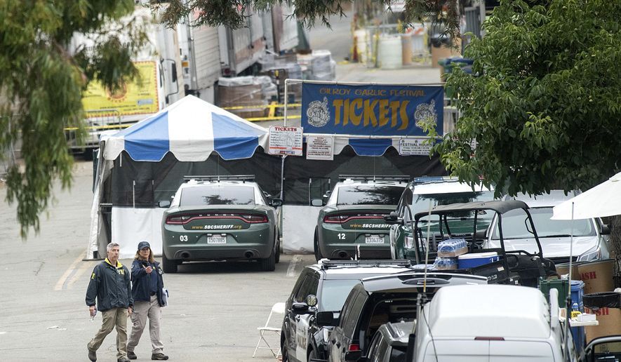 This July 29, 2019, photo shows FBI personnel passing a ticket booth at the Gilroy Garlic Festival in Gilroy,  Calif., the morning after a gunman killed at least three people, including a 6-year-old boy, and wounding about 15 others. The Santa Clara County coroner's office says two of the victims of the Gilroy Garlic Festival shooting died of gunshot wounds to their chests and a third died of a back wound. The office of the medical examiner-coroner says Monday, Aug. 5, 2019, the deaths of Trevor Irby, Keyla Salazar and Stephen Romero are classified as homicides. (AP Photo/Noah Berger) **FILE**