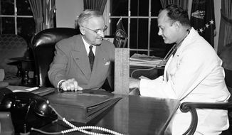 """FILE - In this Sept. 3, 1949, file photo, Brigadier Gen. Wallace Harry Graham, right, personal physician of President Harry S. Truman checks his blood pressure in the president's office in Washington. Seventy years ago, before Medicare existed to inspire """"Medicare for All,"""" a Democratic president wrestled with a challenge strikingly similar to what the party's White House hopefuls face today. Harry Truman, then in his fourth year of pressing for a national health insurance system, parried criticism of his approach in terms that a single-payer health care advocate might use in 2019.(AP Photo/Henry Griffin, File)"""