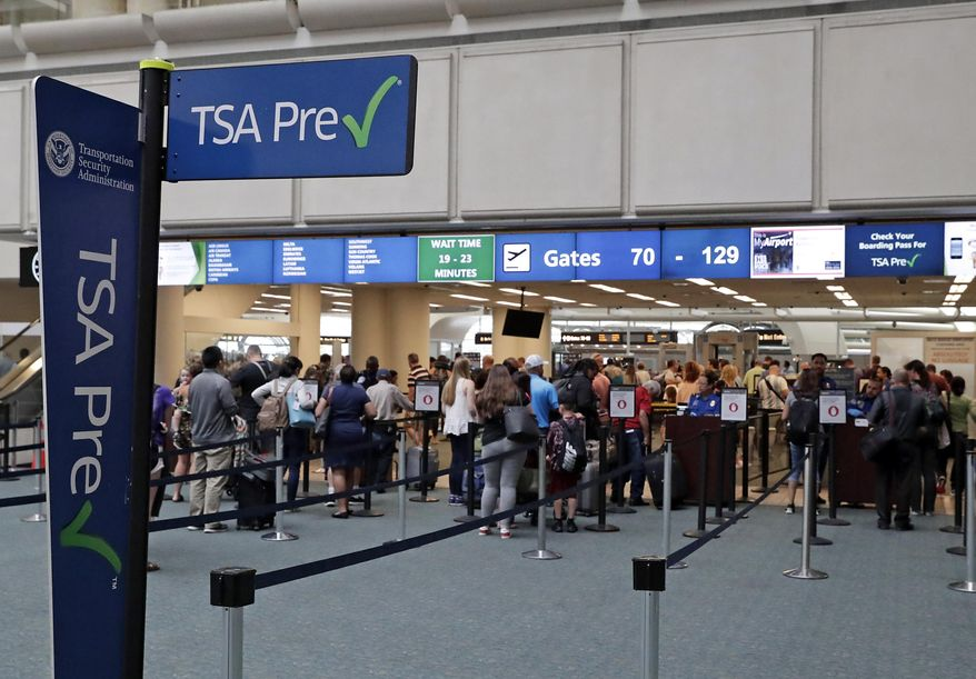 In this Thursday, June 21, 2018, photo, air passengers heading to their departure gates enter TSA pre-check before going through security screening at Orlando International Airport, in Orlando, Fla. (AP Photo/John Raoux) ** FILE **