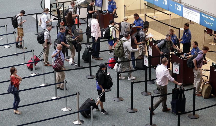In this June 21, 2018 photo air passengers heading to their departure gates enter TSA pre-check before going through security screening at Orlando International Airport, in Orlando, Fla. On Oct. 22, 2019, a three-judge panel in the 9th U.S. Circuit Court of Appeals ruled unanimously to uphold the U.S. government's no-fly list. (AP Photo/John Raoux)