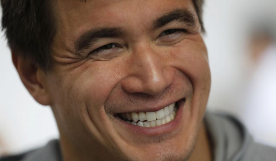 Nathan Adrian, a swimmer from the United States, smiles during an interview at the swimming complex of the Pan American Games in Lima, Peru, Monday, Aug. 5, 2019. Adrian is competing at the Pan American Games just months after being diagnosed with testicular cancer. He has decided to continue training with the goal of competing at Tokyo 2020 Summer Olympics. (AP Photo/Fernando Llano)