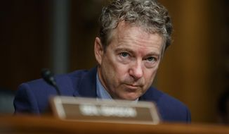 In this March 5, 2019 file photo, Sen. Rand Paul, R-Ky., pauses during a Senate Committee on Health, Education, Labor, and Pensions hearing on Capitol Hill in Washington.  Paul says he underwent lung surgery in a procedure he says stems from injuries suffered when a neighbor tackled him outside his home in 2017. (AP Photo/Carolyn Kaster, FIle) **FILE**