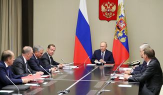 Russian President Vladimir Putin, center, chairs a Security Council meeting in the Kremlin in Moscow, Russia, Monday, Aug. 5, 2019.  Putin said that Russia will only deploy new intermediate-range missiles if the U.S. does, following the demise of a key nuclear pact, and called for urgent arms control talks to prevent a chaotic arms race. (Mikhail Klimentyev, Sputnik, Kremlin Pool Photo via AP)