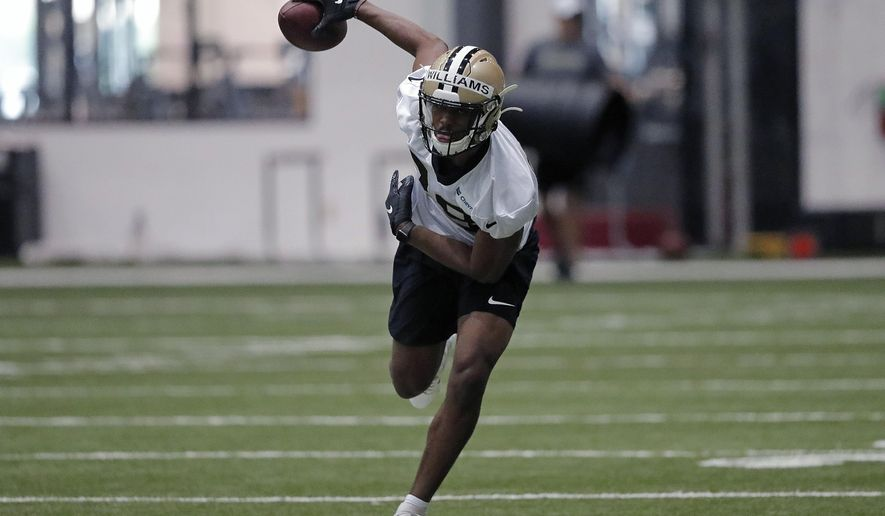 FILE - In this June 12, 2019, file photo, New Orleans Saints free safety Marcus Williams (43) runs a drill at their NFL football training facility in Metairie, La. Marcus Williams asserts that he became a better player in the past year, although his numbers didn't show it. He enters Year 3 aiming to live up to high expectations, even if he may never completely live down a missed tackle in Minnesota that brought a ruinous end to his rookie season. (AP Photo/Gerald Herbert, File)