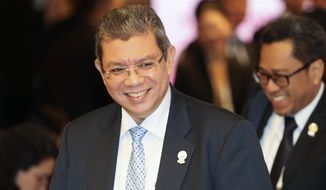 FILE - In this July 31, 2019, file photo, Malaysian Foreign Minister Saifuddin Abdullah smiles as he arrive for the ASEAN Foreign Ministers Meeting plenary session in Bangkok, Thailand. Saifuddin Abdullah said Saturday countries in the region are concerned about rising tensions over the growing numbers of warships plying the South China Sea.(AP Photo/Sakchai Lalit, File)