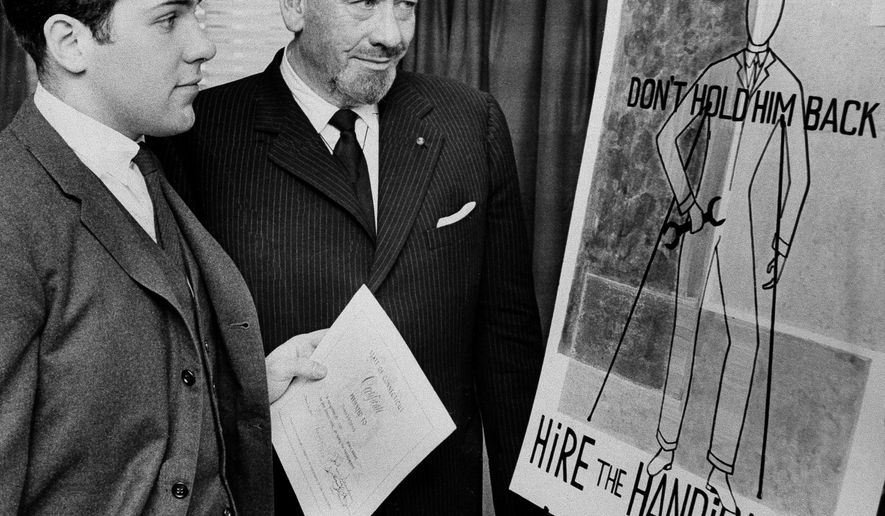 FILE - In this March 22, 1963, file photo, Nobel prize-winning author John Steinbeck, right, admires a prize-winning poster by his son, Thomas Steinbeck in Hartford, Conn. A three-judge panel of the Ninth U.S. Circuit Court of Appeals will be in Alaska's largest city on Tuesday, Aug. 6, 2019, to hear arguments in an appeal by the estate of Steinbeck's late son, Thomas Steinbeck, over a 2017 ruling in California. In that case, a federal jury awarded the author's stepdaughter Waverly Scott Kaffaga, more than $13 million in a lawsuit claiming Steinbeck's son and daughter-in-law impeded film adaptations of the iconic works. (AP Photo, File)
