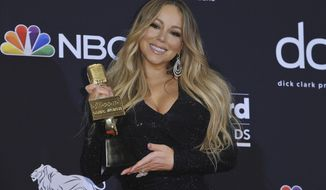 """FILE - In this May 1, 2019, file photo Mariah Carey poses in the press room with the Icon award at the Billboard Music Awards at the MGM Grand Garden Arena in Las Vegas. ABC announced Monday, Aug. 5, that Carey has co-written and sings the theme music to ABC's new """"black-ish"""" spinoff """"mixed-ish."""" (Photo by Richard Shotwell/Invision/AP, File)"""