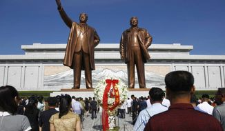 "FILE - In this July 8, 2019, file photo, people visit Mansu Hill to pay tribute to the late leaders Kim Il Sung and Kim Jong Il on the occasion of the 25th anniversary of Kim Il Sung's death, in Pyongyang, North Korea. A panel monitoring U.N. sanctions said Monday, Aug. 5, that North Korean cyber experts have illegally raised money for the country's weapons of mass destruction programs ""with total proceeds to date estimated at up to $2 billion."" (AP Photo/Jon Chol Jin, File)"