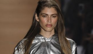 In this March 16, 2017, file photo Brazilian transgender model Valentina Sampaio wears a creation from the Amir Slama collection during Sao Paulo Fashion Week in Sao Paulo, Brazil. Sampaio has become the first openly transgender model hired by Victoria's Secret nearly a year after a top company official was pressured to apologize for implying trans women are off brand. (AP Photo/Andre Penner, File)