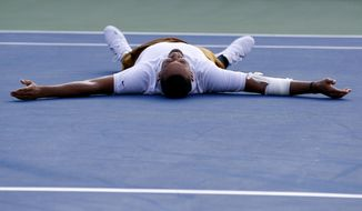 Nick Kyrgios, of Australia, falls to the court as he reacts after defeating Daniil Medvedev, of Russia, in a final match at the Citi Open tennis tournament, Sunday, Aug. 4, 2019, in Washington. (AP Photo/Patrick Semansky) **FILE**