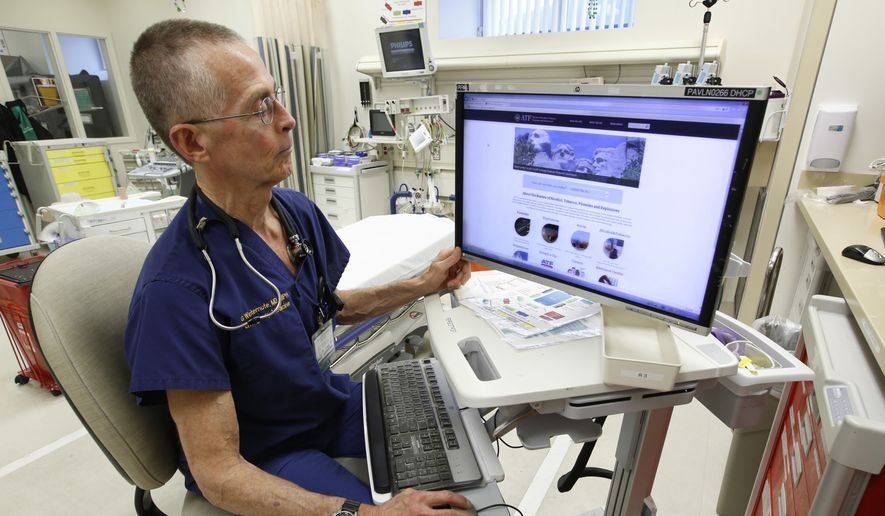 ADVANCE FOR USE MONDAY, MARCH 13, 2017 AND THEREAFTER-Dr. Garen Wintemute, an emergency room physician at the University of California, Davis, Medical Center, shows the website of the Bureau of Alcohol, Tobacco and Firearms, on a computer in the hospital in Sacramento, Calif., on Thursday, March 9, 2017. (AP Photo/Rich Pedroncelli) **FILE**