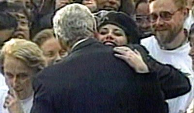 In this Nov. 6, 1996 file image taken from video, Monica Lewinsky embraces President Clinton as he greeted well-wishers at a White House lawn party in Washington Nov. 6, 1996. The long-running drama of Hillary Clinton's marriage _ her husband's infidelity and how she dealt with it _ is back as a subtext in this year's presidential race.   (AP Photo/APTV)