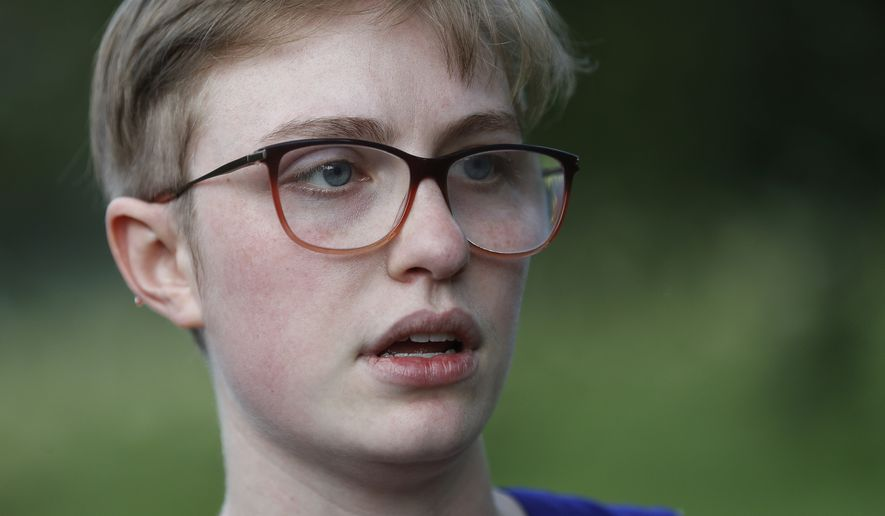 Adelia Johnson, who briefly dated Connor Betts, who fatally gunned down people on Sunday in Dayton, Ohio, speaks to members of the media in Belmont Park in Dayton on Tuesday, Aug. 6, 2019. (AP Photo/John Minchillo)