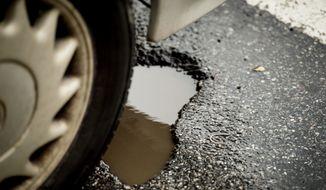 potholes along Florida Ave. in Northwest, Washington, D.C., Wednesday, March 19, 2014. (Andrew Harnik/The Washington Times) **FILE**