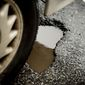 potholes along Florida Ave. in Northwest, Washington, D.C., Wednesday, March 19, 2014. (Andrew Harnik/The Washington Times) **FILE**