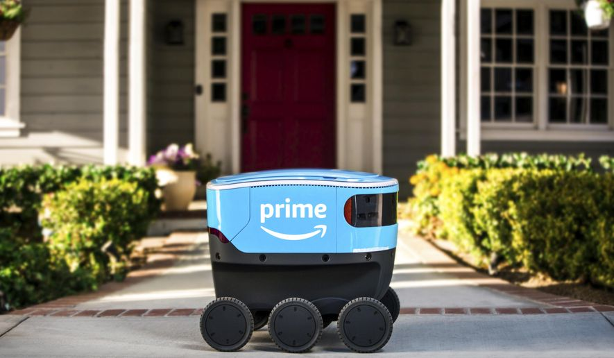FILE - This undated photo provided by Amazon shows a self-driving delivery robot that Amazon is calling Scout.  Amazon is expanding the use of its self-driving delivery robots to a second state.The online shopping giant says the six-wheeled robots, about the size of a Labrador, will start delivering packages to customers in Irvine, Calif. Amazon.com Inc. has been testing them in a Seattle suburb since the beginning of the year. (Amazon via AP, File)