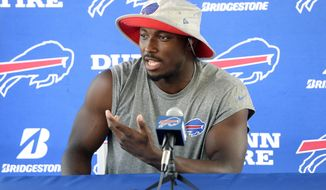 """FILE - In this July 26, 2018, file photo, Buffalo Bills running back LeSean McCoy speaks to the media at the NFL football team's training camp in Pittsford, N.Y. LeSean McCoy says he's heard people question whether he's lost a step at the age of 31 and using that as motivation entering his 11th NFL season. Coming off his least productive year, McCoy insists he still considers himself being what he referred to as """"The Guy"""" in Buffalo's backfield, and intends to prove that on Sundays. McCoy addressed reporters following the Bills' final session of training camp in suburban Rochester on Tuesday, Aug. 6, 2019. (AP Photo/Adrian Kraus, File)"""