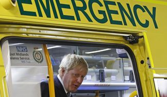 Britain's Prime Minister Boris Johnson visits Pilgrim Hospital in Boston, north east England, Monday Aug. 5, 2019. Boris Johnson says he will pump an additional 1.8 billion pounds ($2.2 billion) into the National Health Service, feeding speculation he wants an early election to bolster his one-seat majority in Parliament and support for his Brexit plans. (Darren Staples/Pool via AP)