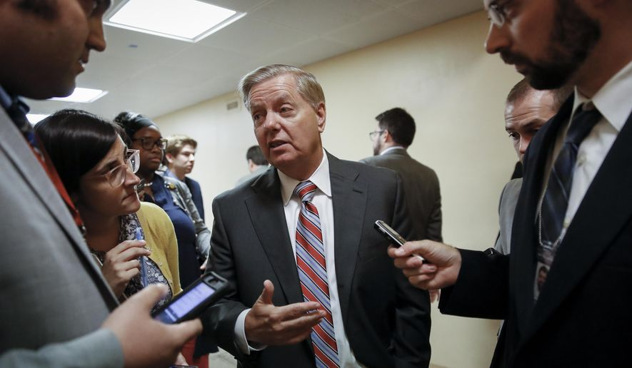 Senate Judiciary Committee Chairman Lindsey Graham, R-S.C., talks to reporters on his way to the Senate chamber for votes on July 31, 2019. (AP Photo/J. Scott Applewhite) **FILE**