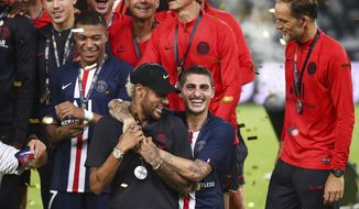 Paris Saint-Germain players Neymar, left at front, and Marco Verratti, right at front, celebrate after winning their match against Rennes in the Trophee des Champions in Shenzhen in southern China's Guangdong province, Saturday, Aug. 3, 2019. Paris Saint-Germain beat Rennes, 2-1. (Color China Photo via AP)