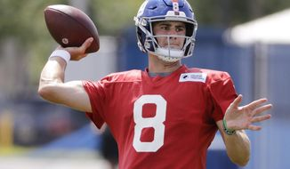 FILE - In this July 25, 2019, file photo, New York Giants' quarterback Daniel Jones throws a pass at the NFL football team's training camp in East Rutherford, N.J. The New York Giants are finally going to get a glimpse of Daniel Jones in an NFL game. The sixth pick overall in the draft, Jones is going to get his first snaps in live action when the Giants face the New York Jets on Thursday, Aug. 8, 2019 at MetLife Stadium. (AP Photo/Frank Franklin II, File)