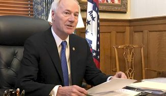 FILE - In this April 10, 2019 file photo, Arkansas Gov. Asa Hutchinson speaks to reporters in his office at the state Capitol in Little Rock, Ark. Hutchinson says the state should have harsher penalties for people convicted of targeting others because of their race, ethnicity or religion, calling for the measure in the wake of two mass shootings that include one in Texas being investigated as a hate crime by federal authorities. Gov. Hutchinson told a group of sheriffs on Tuesday, Aug. 6, 2019, that he wants to end the state's distinction as only one of four states without a hate crimes law. (AP Photo/Andrew DeMillo)