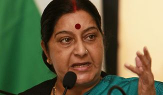 FILE - In this April 21, 2012, file photo, Indian lawmaker Sushma Swaraj speaks during a press conference in Colombo, Sri Lanka. Former Indian foreign minister Swaraj passed away in a New Delhi hospital on Tuesday, Aug. 6, 2019. She was 67. (AP Photo/Gemunu Amarasinghe, File)