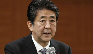 Japanese Prime Minister Shinzo Abe speaks during a press conference in Hiroshima, western Japan Tuesday, Aug. 6, 2019. Prime Minister Abe says the biggest problem between his country and South Korea is a loss of trust resulting from the wartime labor dispute, which Japan initially linked to the export control measures against South Korea but stayed away after Seoul accused Tokyo of weaponizing trade as retaliation.(Juntaro Yokoyama/Kyodo News via AP)