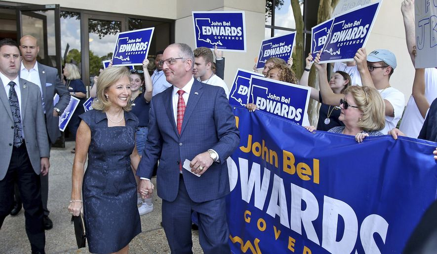 Louisiana Governor John Bel Edwards and his wife Donna leave the Louisiana Secretary of State's office after he signed up to run in the upcoming election, in Baton Rouge, La., Tuesday, August 6, 2019.  (AP Photo/Michael DeMocker)