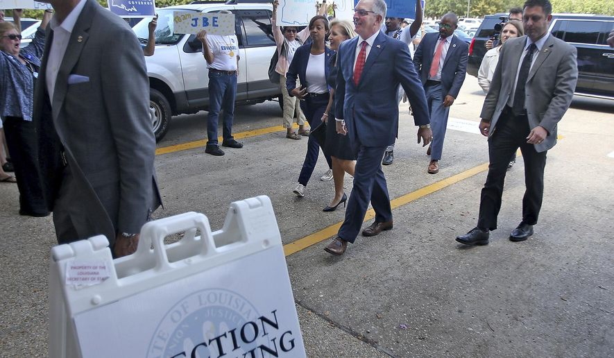 Louisiana Governor John Bel Edwards and his wife Donna arrive at the Louisiana Secretary of State's office to sign up to run in the upcoming election, in Baton Rouge, La., Tuesday, August 6, 2019. The candidate sign-up period for Louisiana's statewide elections ends Thursday, with the governor's race at the top of the ballot. (AP Photo/Michael DeMocker)