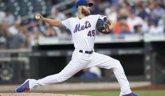 New York Mets starting pitcher Zack Wheeler delivers during the first inning of the team's baseball game against the Miami Marlins, Tuesday, Aug. 6, 2019, in New York. (AP Photo/Mary Altaffer)