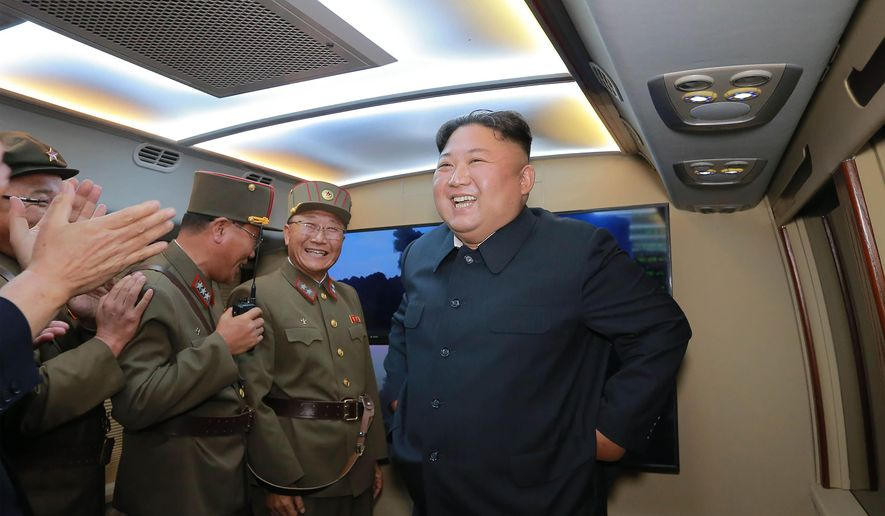 """In this Tuesday, Aug. 6, 2019, photo provided by the North Korean government, North Korean leader Kim Jong-un, right, visits an airfield in the western area of North Korea to watch its weapons demonstrations. The content of this image is as provided and cannot be independently verified. Korean language watermark on image as provided by source reads: """"KCNA"""" which is the abbreviation for Korean Central News Agency. (Korean Central News Agency/Korea News Service via AP)"""