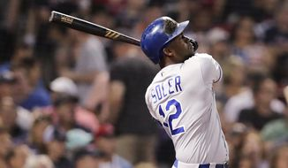 Kansas City Royals' Jorge Soler watches his home run blast during the fourth inning of a baseball game against the Boston Red Sox at Fenway Park in Boston, Tuesday, Aug. 6, 2019. (AP Photo/Charles Krupa)