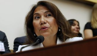 In this July 24, 2019, file photo, Rep. Veronica Escobar, D-Texas, asks questions to former special counsel Robert Mueller, as he testifies before the House Judiciary Committee hearing on his report on Russian election interference, on Capitol Hill in Washington. The Walmart shooting in El Paso, Texas, has made Escobar a member of a club no lawmaker wants to join. Escobar is consoling constituents traumatized by the shooting, which killed at least 22 people. (AP Photo/Alex Brandon, File)