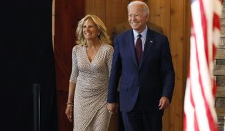 Democratic presidential candidate former Vice President Joe Biden arrives with his wife Jill to speak at a community event, Wednesday, Aug. 7, 2019, in Burlington, Iowa. (AP Photo/Charlie Neibergall)
