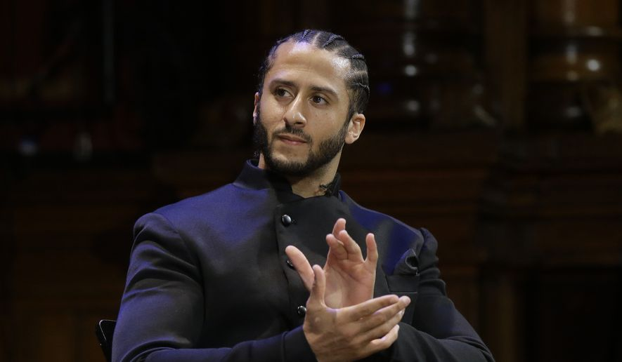 "In this Oct. 11, 2018, file photo, former NFL football quarterback Colin Kaepernick applauds while seated on stage during W.E.B. Du Bois Medal ceremonies at Harvard University in Cambridge, Mass. Colin Kaepernick says he's ""still ready"" to return to the NFL, even though he is set to enter his third season out of the league. In a video posted Wednesday, Aug. 7, 2019 on social media, the 31-year-old Kaepernick is shown working out in a gym. He says in the video: ""5 a.m. 5 days a week. For 3 years. Still Ready."" (AP Photo/Steven Senne, File) **FILE**"