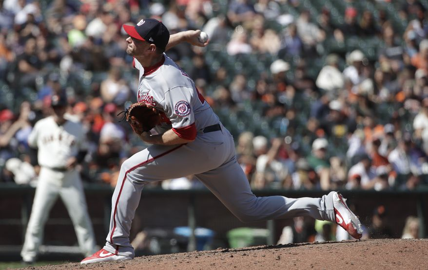 Washington Nationals pitcher Daniel Hudson (44) throws against the San Francisco Giants during the ninth inning of a baseball game in San Francisco, Wednesday, Aug. 7, 2019. (AP Photo/Jeff Chiu) ** FILE **