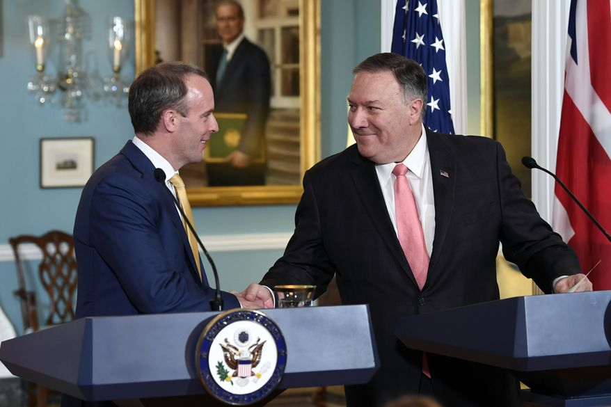 Secretary of State Mike Pompeo, right, shakes hands with Britain's Foreign Secretary Dominic Raab, left, during a press availability at the State Department in Washington, Wednesday, Aug. 7, 2019. (AP Photo/Susan Walsh)