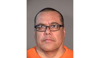 This undated photo provided by the Arizona Department of Corrections shows Alan Champagne, who was convicted of killing two people whose bodies were found buried in his mother's backyard in Phoenix. The Arizona Supreme Court is scheduled to issue a decision Wednesday, Aug. 7, 2019, in Champagne's appeal. (Arizona Department of Corrections via AP)